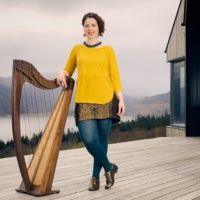 Pippa and her harp by a loch