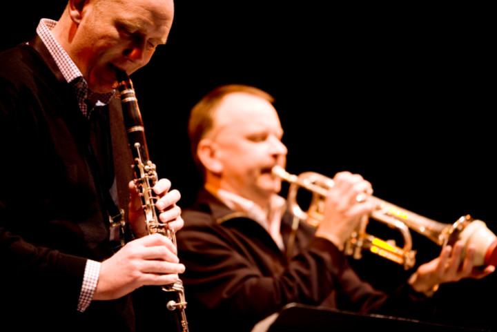 two male jazz musicians playing the bassoon and trumpet