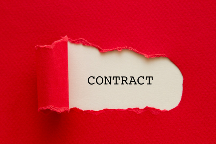 The word contract on a shown through a folder