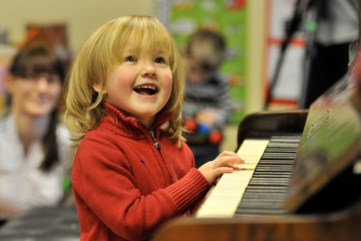 Child performing at piano at Huddersfield Contemporary Music Festival
