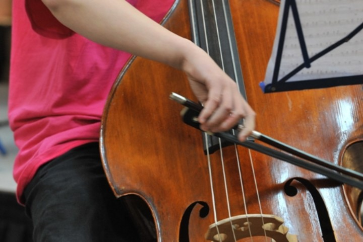 Child playing the double bass