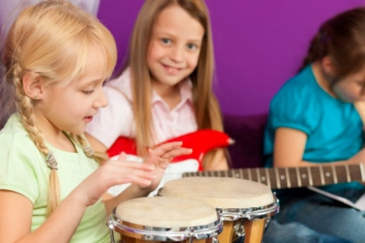 picture of young children playing musical instruments