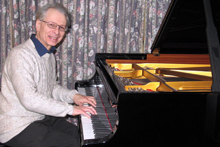 ISM member Clifford Evans at the piano