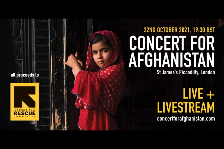 Young Afghani girl looks at the camera with the words Concert for Afghanistan