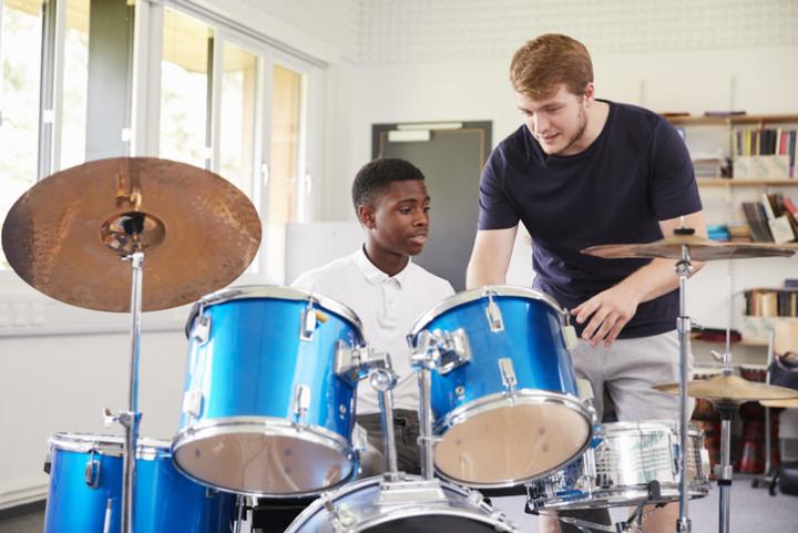 Man teaches drum lesson