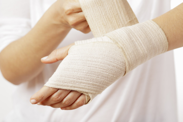 Hand with a bandage on
