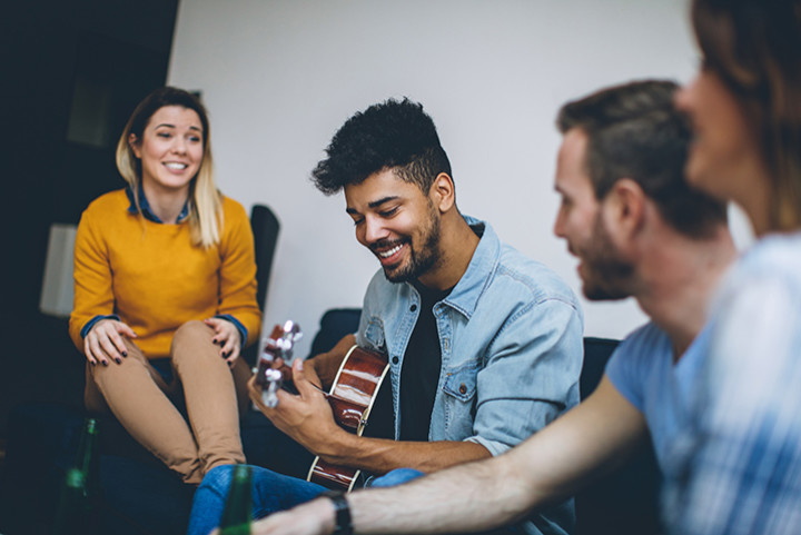 guitarist playing with friends