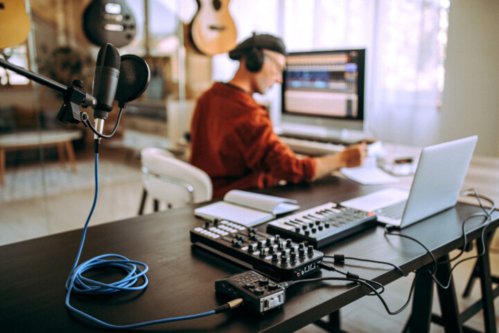 A musician works from a home studio