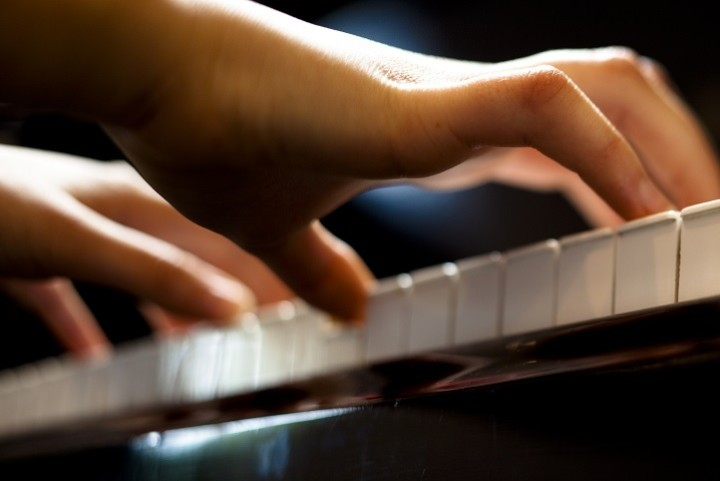 Childs hand on piano