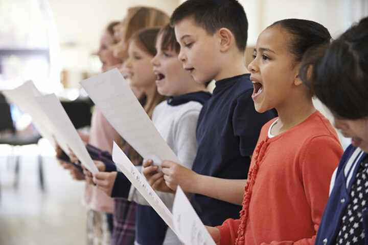 School children singing in a choir.