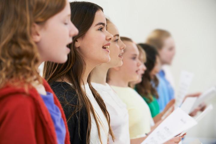 School girls singing