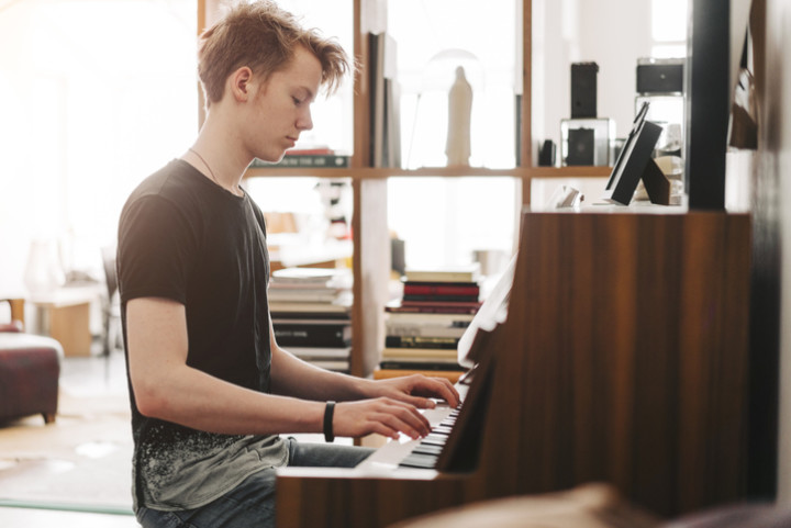 Teenage boy playing piano