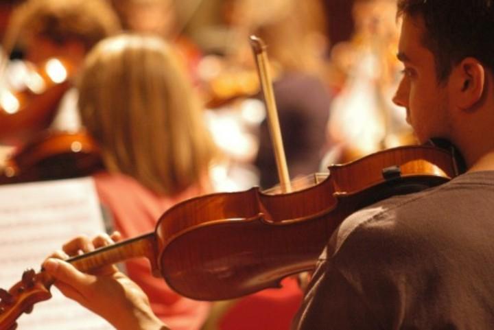 Violin student playing