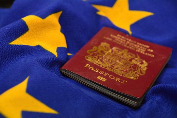 photo of British passport atop a EU flag