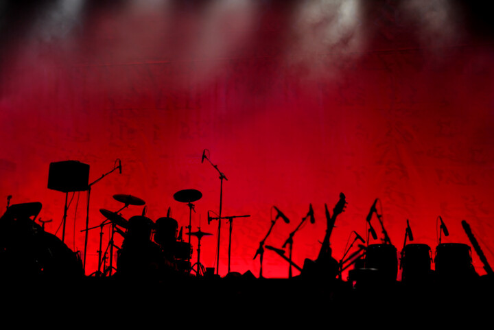 Silhouette of music instruments on concert stage
