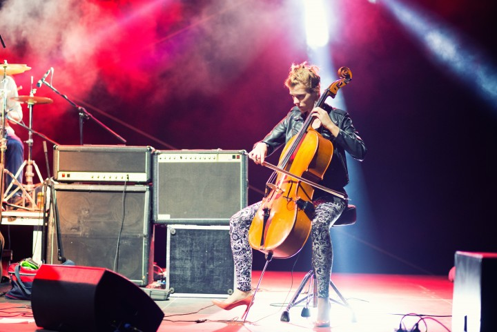 Performer plays cello on stage