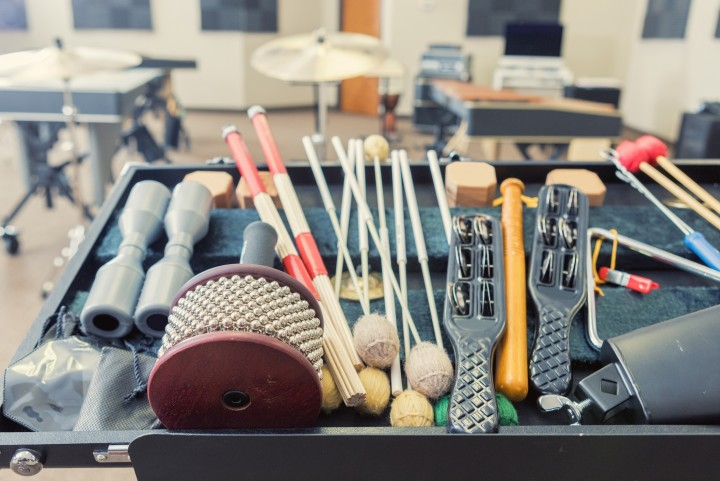 Percussion instruments and sticks in a classroom