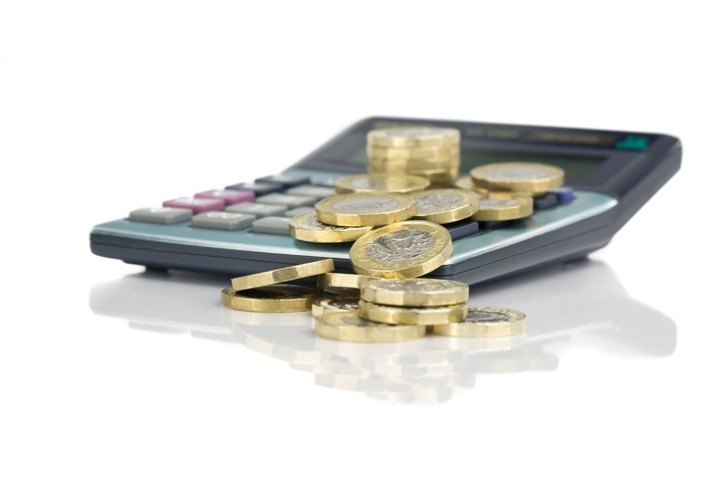 Pound coins on a calculator