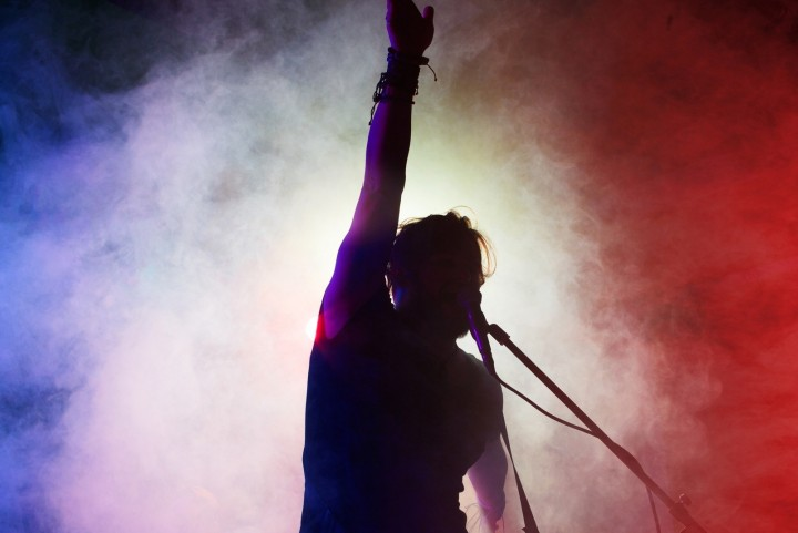 silhouette of performer on stage