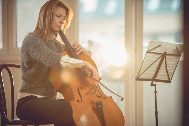 cellist plays at home