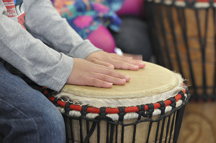 hands playing a drum