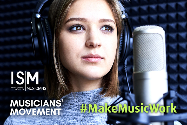 A vocalist looks off into the distance.  She is wearing headphones and has a microphone in front of her. Hashtag Make Music Work is superimposed onto the image, as well as the ISM and Musicians Movement logos.
