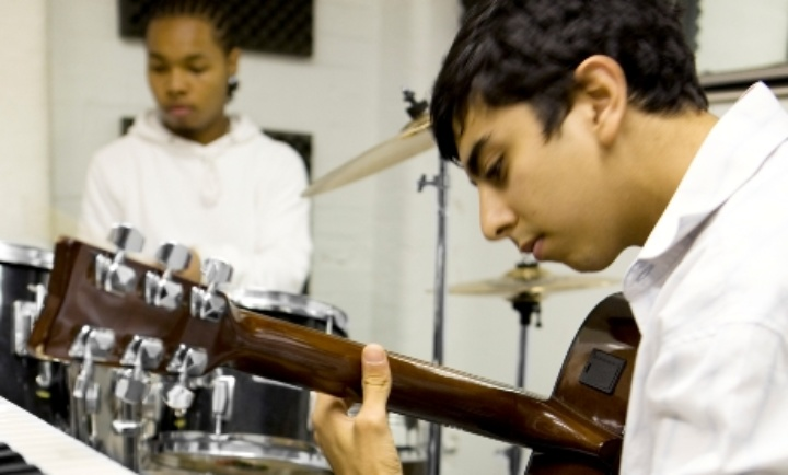 Pupils playing guitar