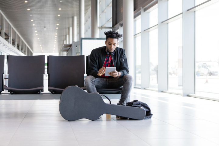 musician waiting at the airport