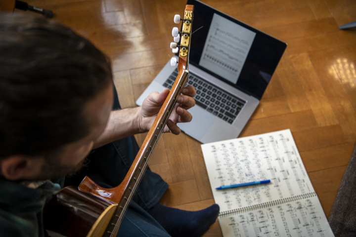 Guitarist composes from home on a laptop