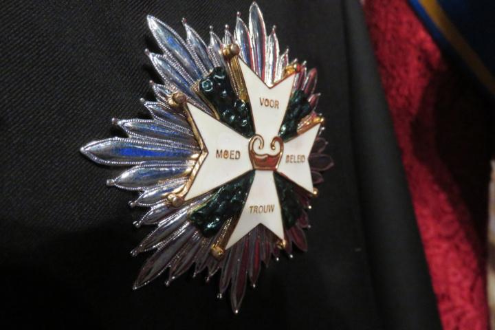 A star of the garter medal adorns a cloak