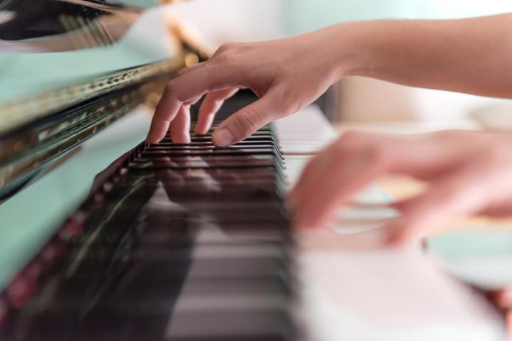 Hand on piano