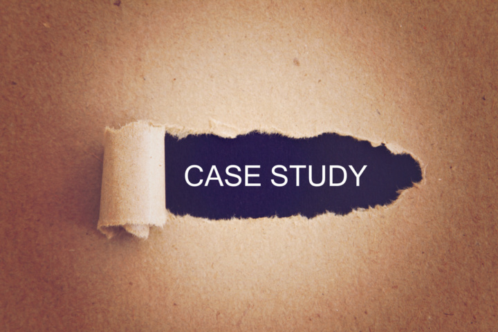 A fingernail tears back an envelope to display the words 'Case Study' underneath