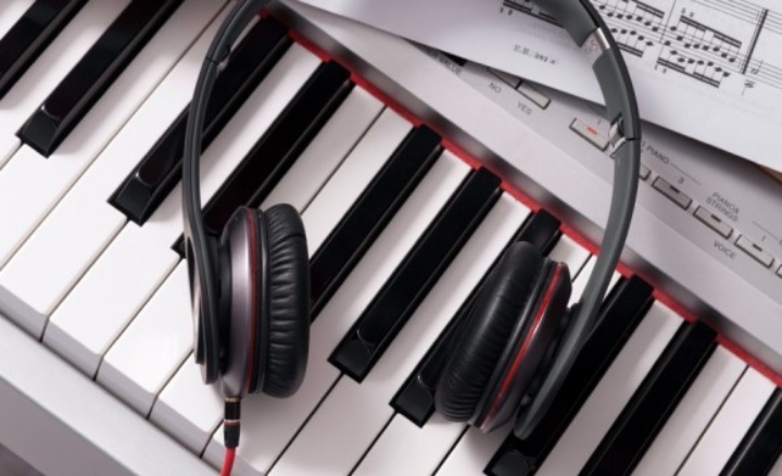 Headphones lying on a keyboard