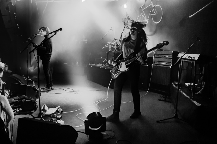 black and white photo of a live band performing on stage