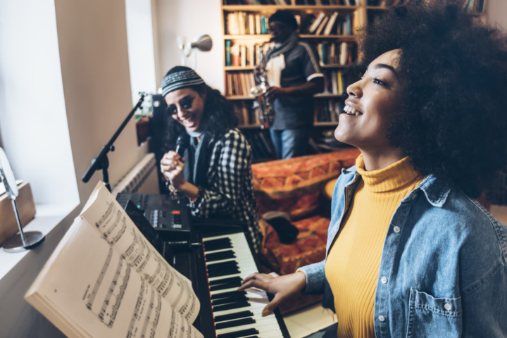 musicians at a brand practice having fun