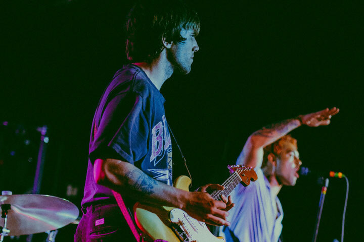 Guitarist and lead singer in a band on stage
