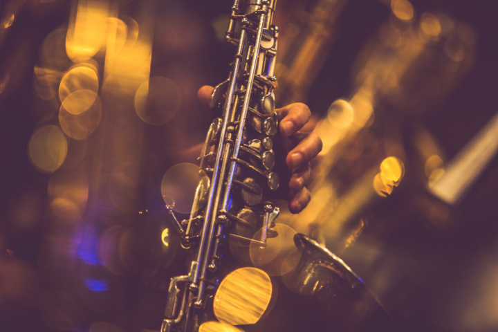 close up picture of saxophone in concert lights