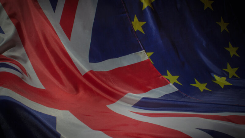 A union flag and an EU flag next to each other.